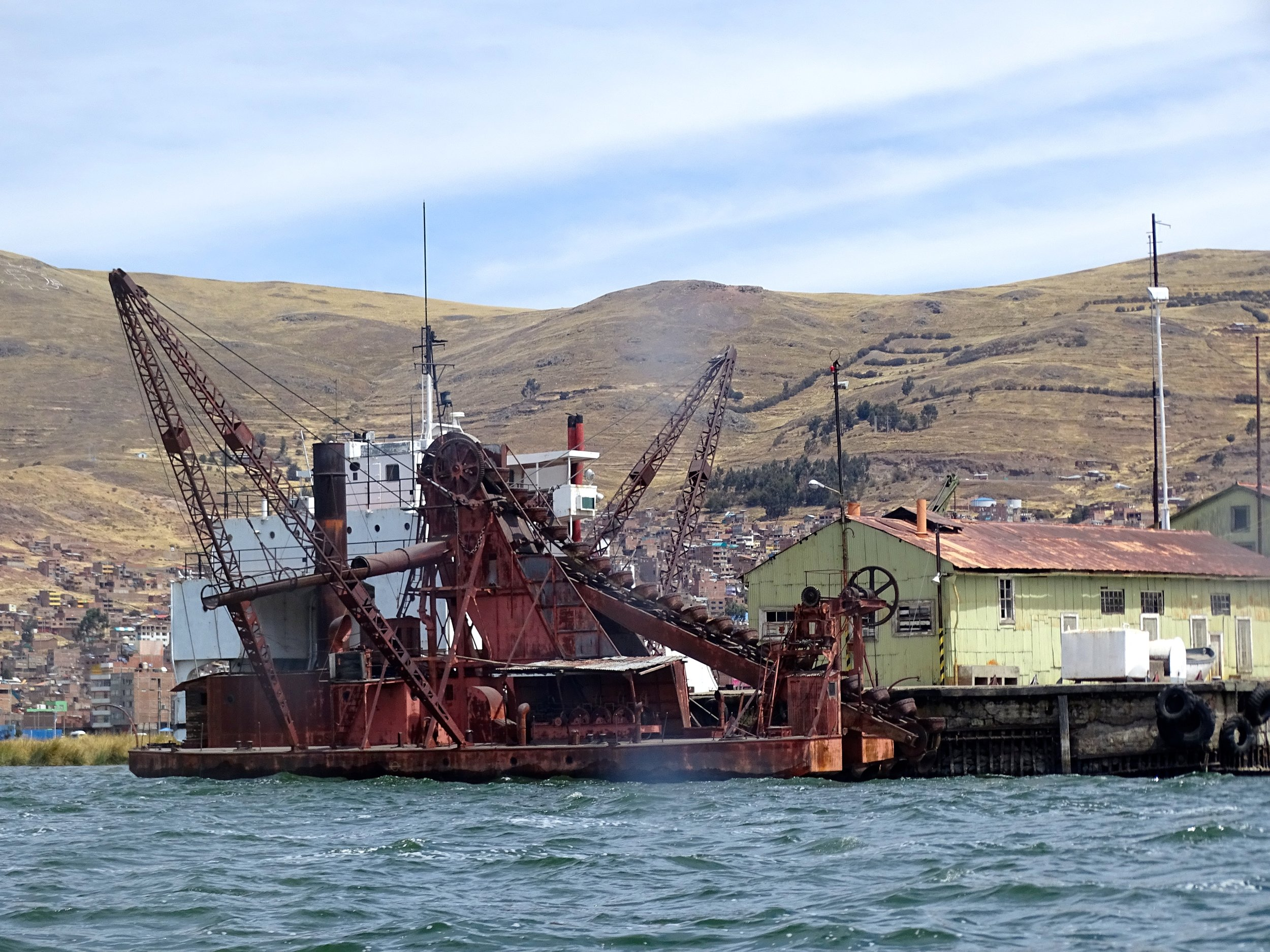 An old dredge along the waterfront in Puno.  I suspect this was used to open the channel out through the reed marsh, and make the passage much quicker.