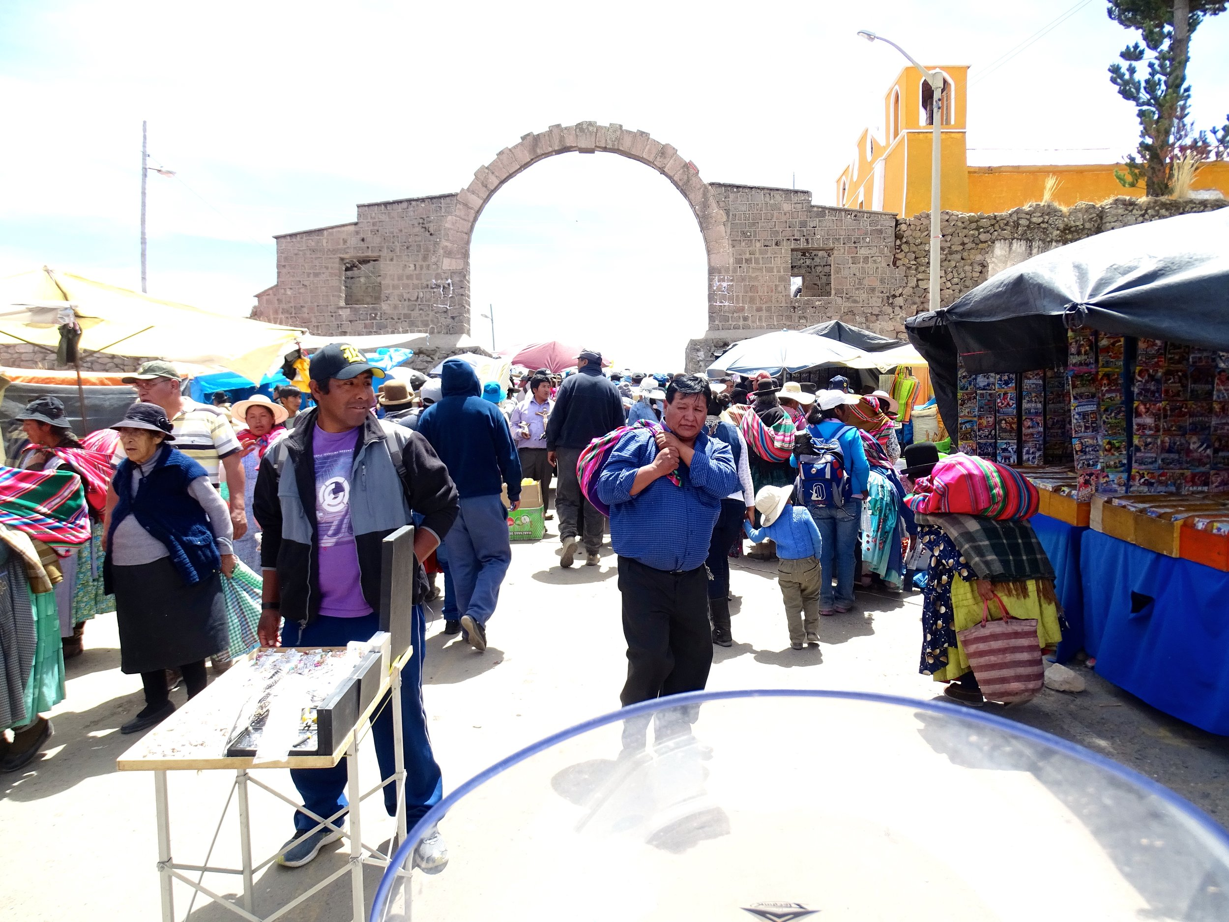Everything funneled into one street, which led under this stone arch marking the border between Peru and Bolivia.