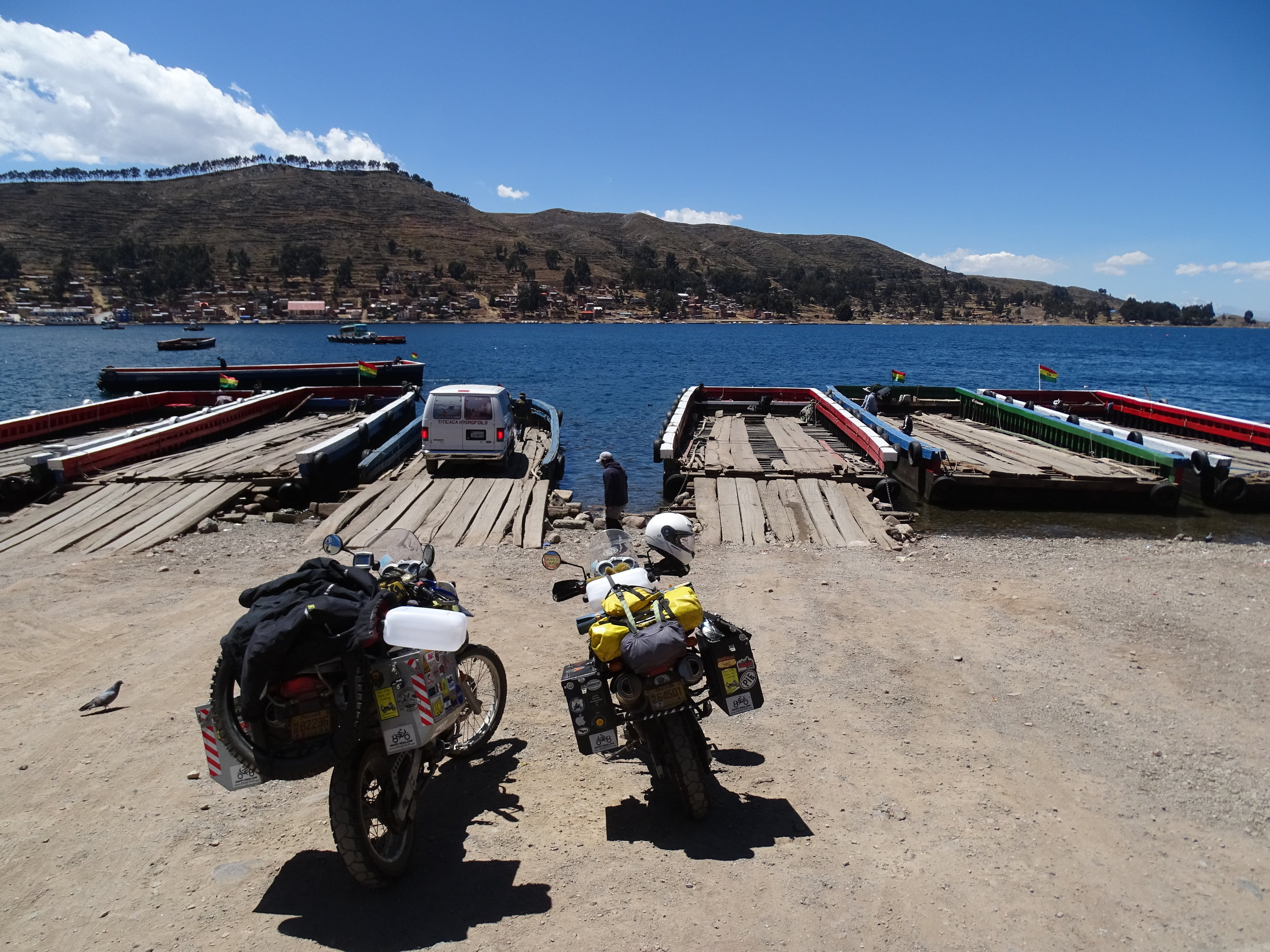"These wooden ferries cross a very narrow channel connecting the two ""halves"" of Lago Titicaca."