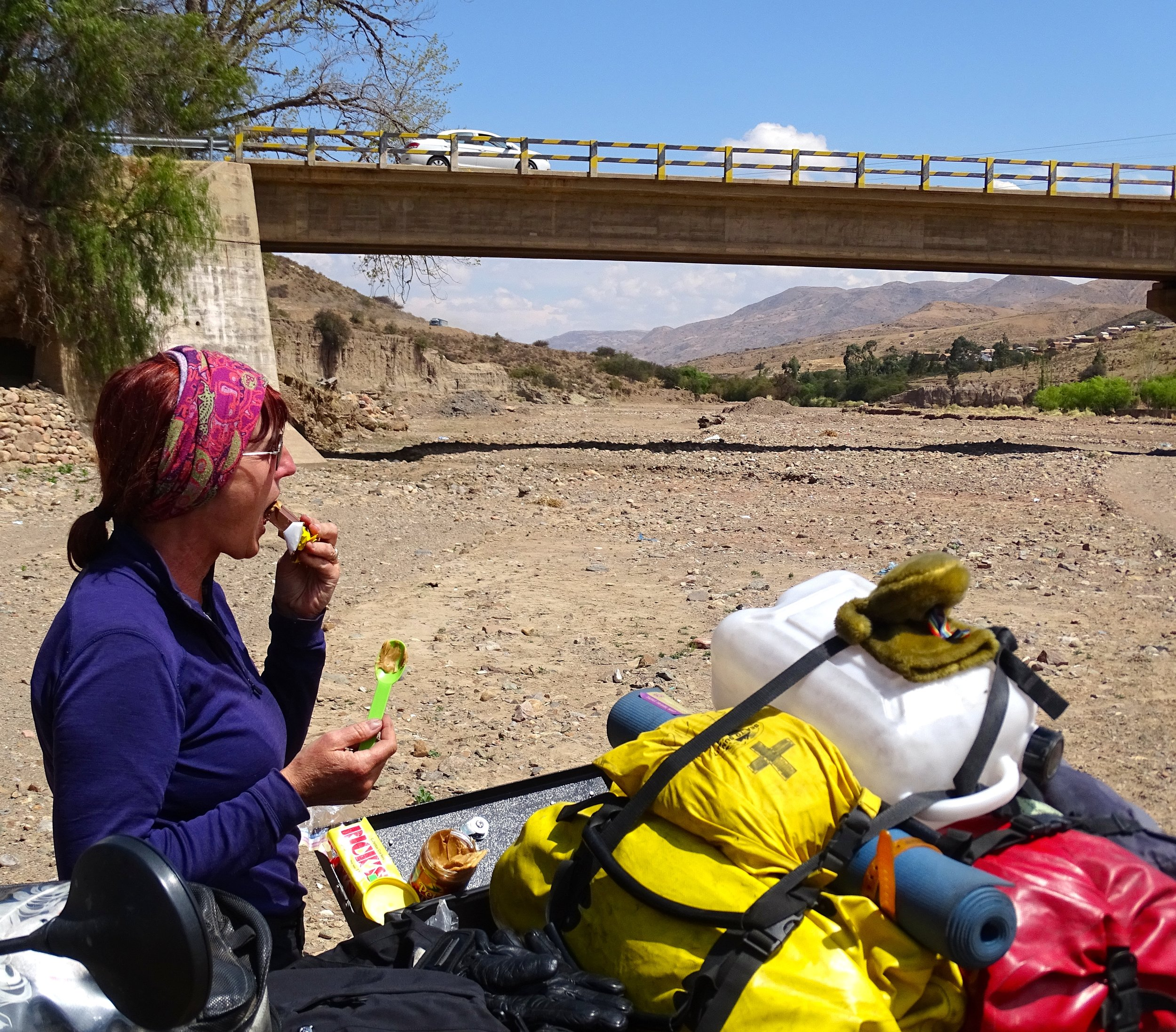 Our lunch stop that day was a mostly-dry riverbed.  After crossing that bridge we took a hard left, and followed the rocky road to a good parking spot, which turned out to be the riverbed.