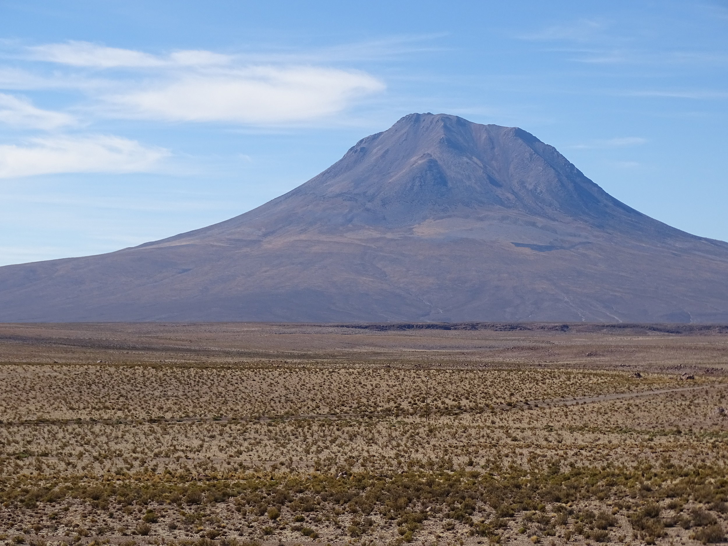 Lots of old volcanoes mark this region.  On this day we crested the Andes headed west, and descended into the Atacama Desert.
