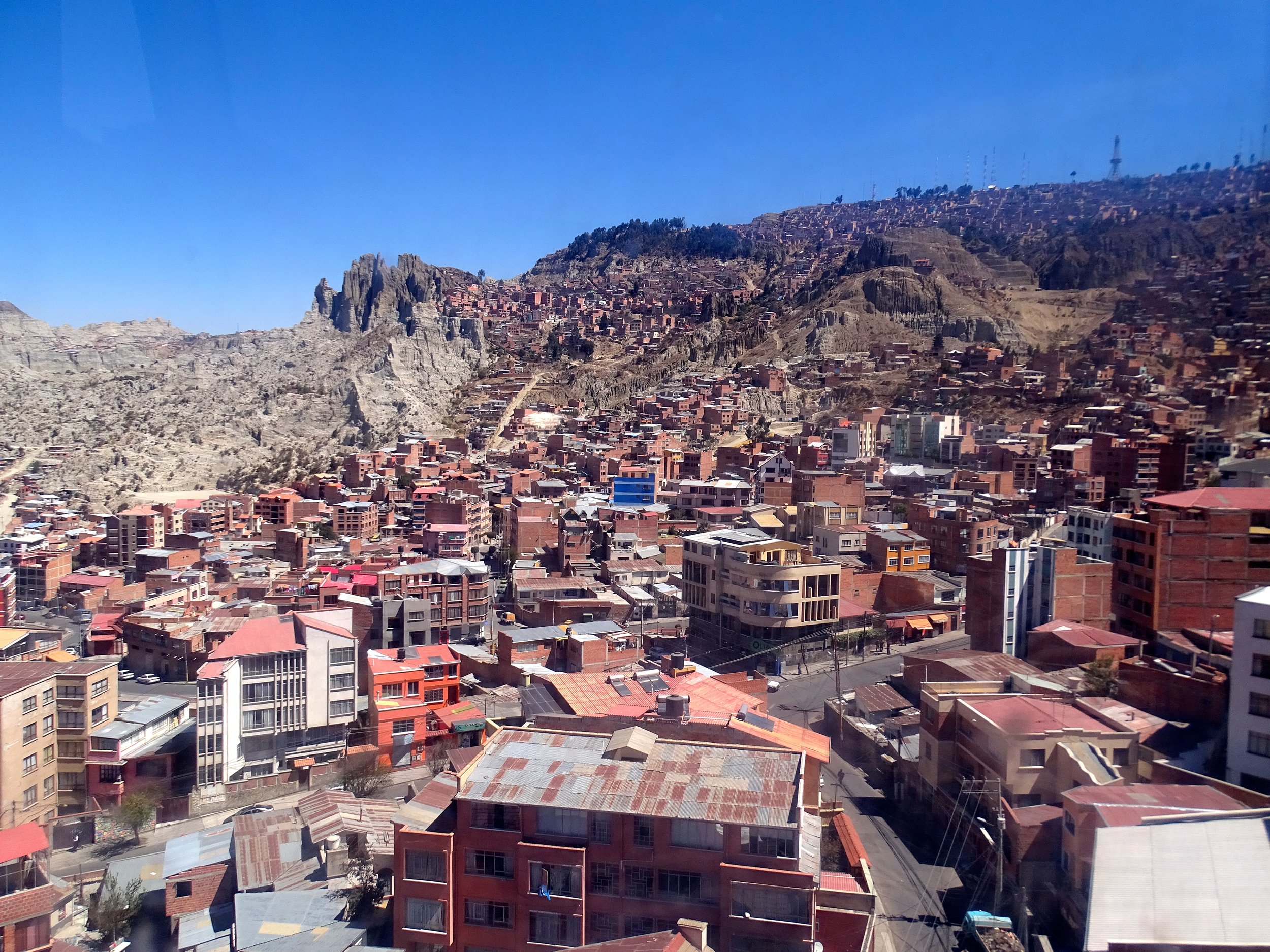 Next few photos: Views from the gondola ride up to the Mirador on the gondola.  La Paz is like a big bowl, and El Alto is above it on the plateau to the left.