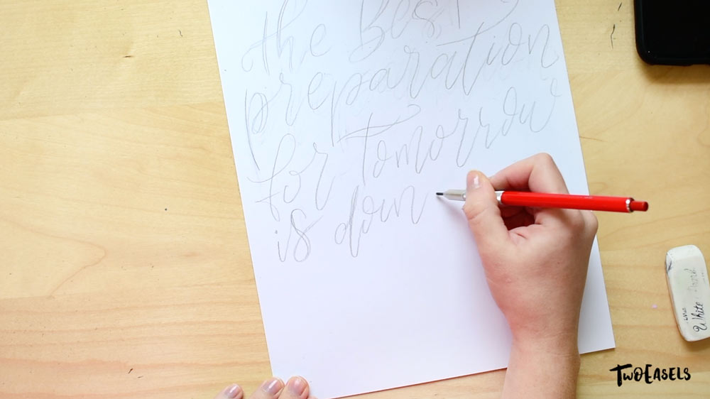 start by sketching out your lettering idea