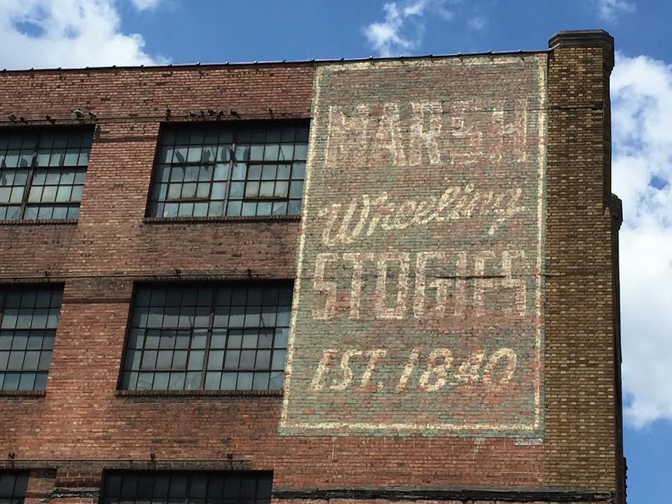 The ghost signs for Marsh Stogies, which drape the factory building between Main and Market Streets by the Fort Henry Bridge, are among the most iconic in the Friendly City.