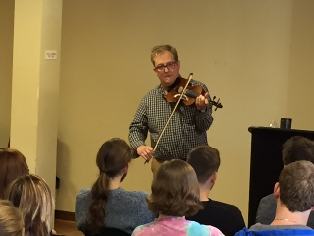 Doug Van Gundy plays a tune during his lecture Wednesday at West Liberty University.