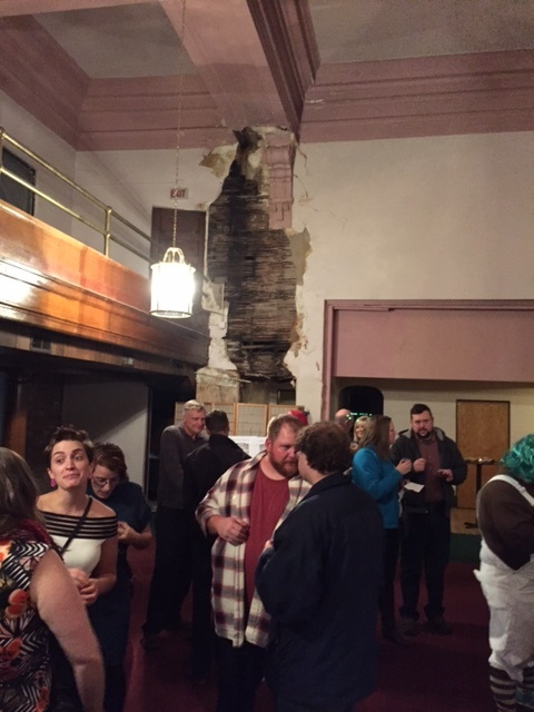 Partygoers at last week's Beertastic Brew Bash, at the old Church of the Word, enjoyed themselves beneath a gaping gash in the rear wall. The church's roof is failing, causing extensive water damage.