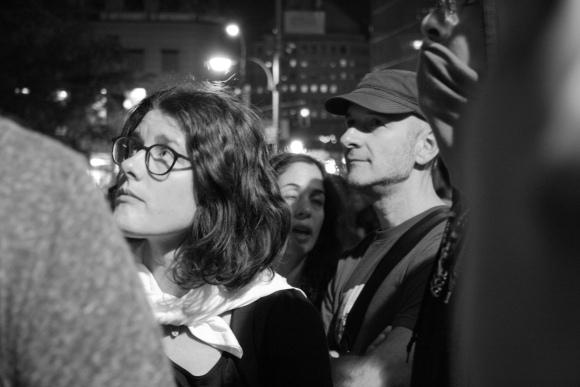 8 October 2011 A young woman listens carefully to a protester explaining his ideologies in Zuccotti park.