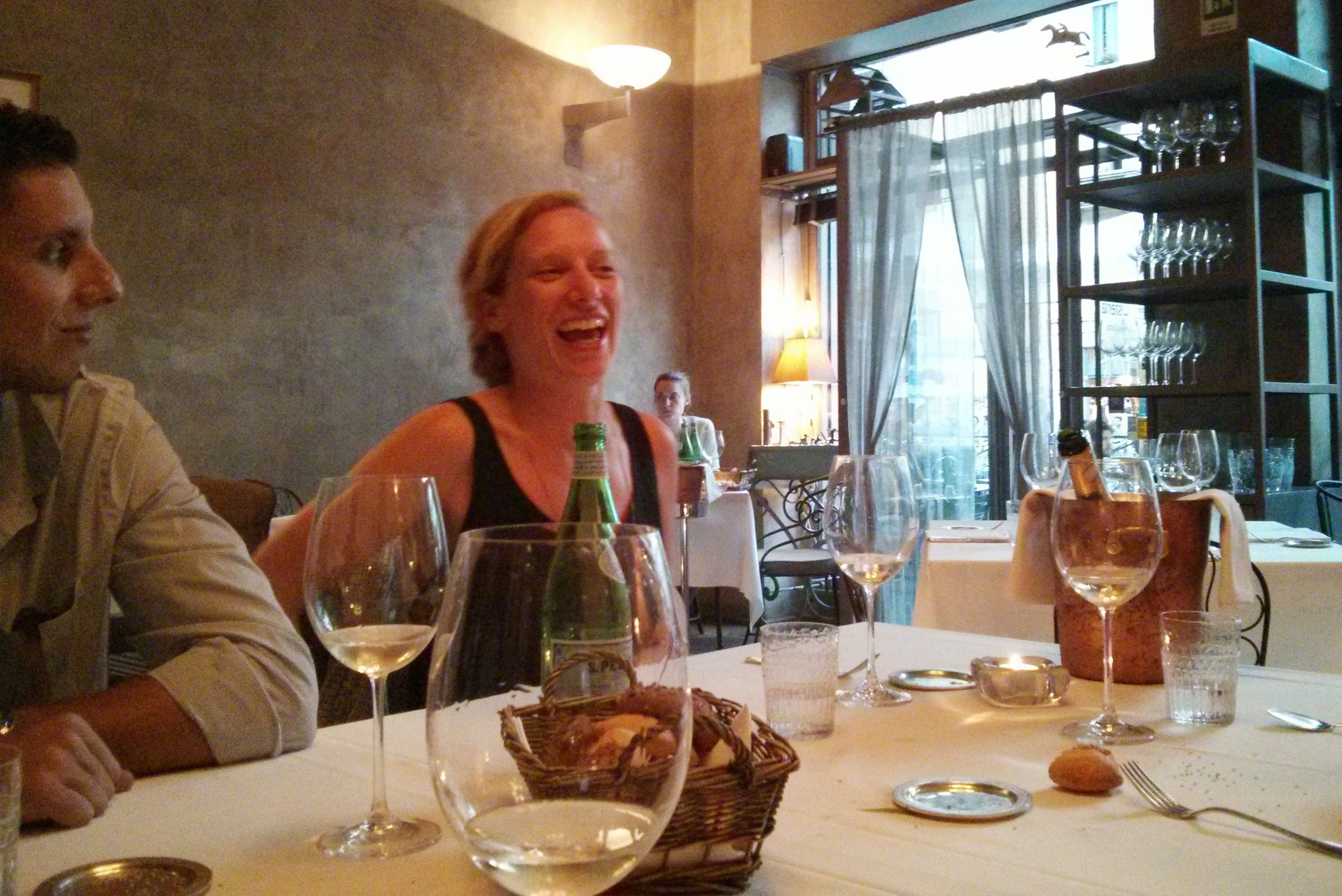 Photo of people enjoying their time at a restaurante during a Sonoma Yoga Privates event.  This photo links to the Sonoma Yoga Privates' event page.