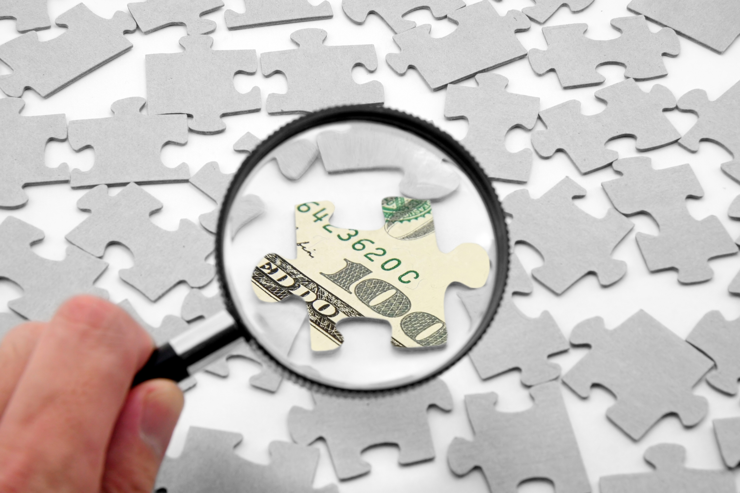 stock-photo-us-dollar-puzzle-and-magnifier-business-concept-2107346.jpg