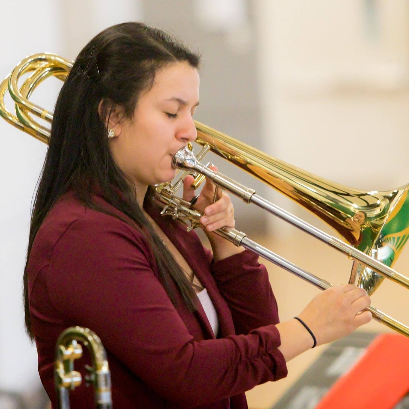 "Gina ""Badeeduh"" Benalcazar   Trombonist/ Composer/ Arranger/ Educator   Click image to visit website."