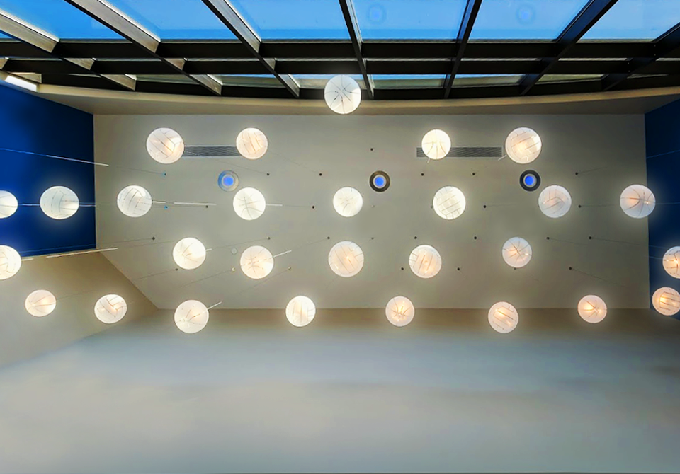 the SKY truly was the limit. - In collaboration with Brooklyn-based Shakuff, over 30 basketball and volleyball-shaped glass pendants were hung in the arena entrance, giving guests an unexpected welcome to the Bluejays' nest.
