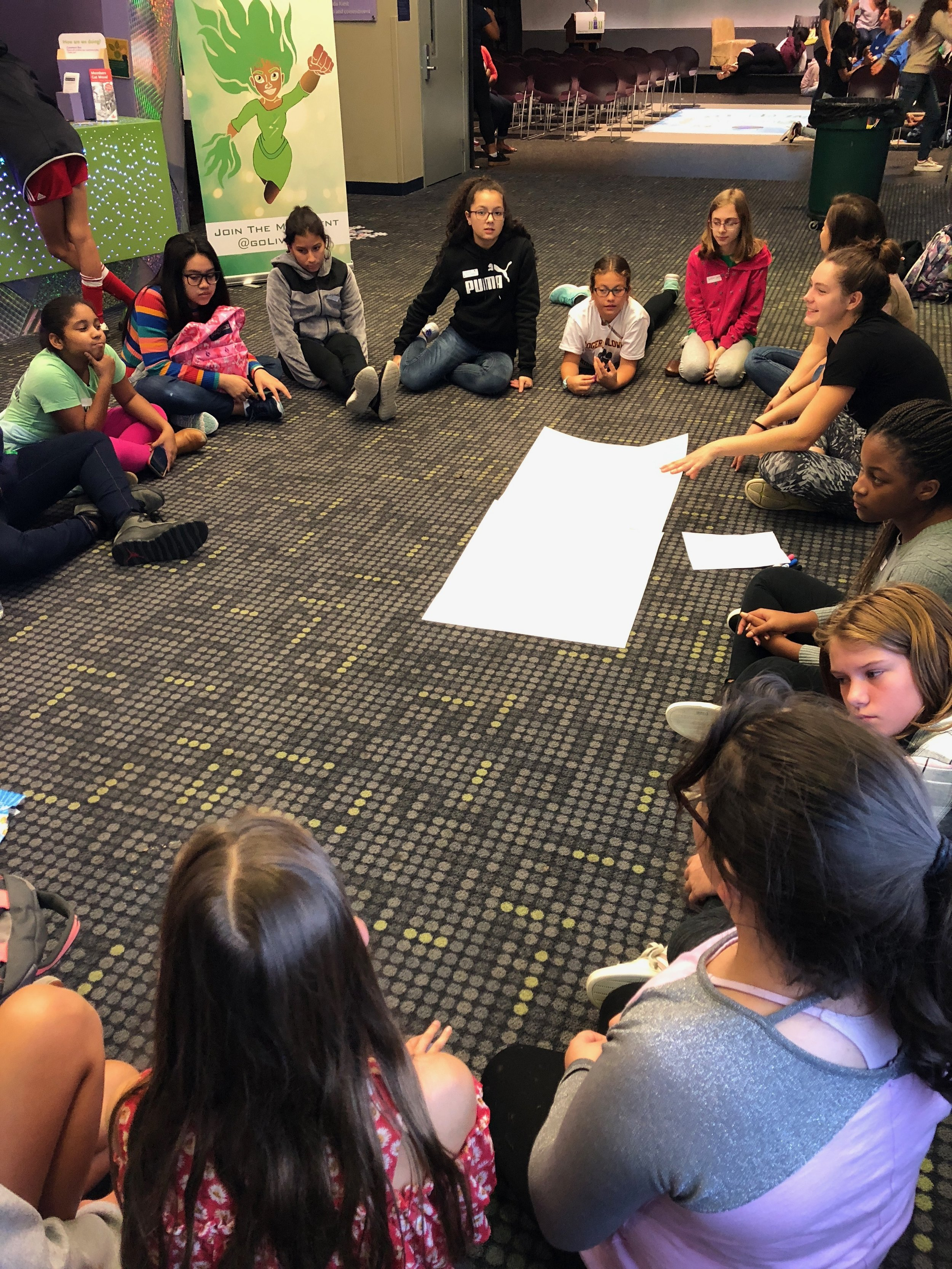 High School Mentors facilitate a discussion with middle school girls around the International Day of the Girl.