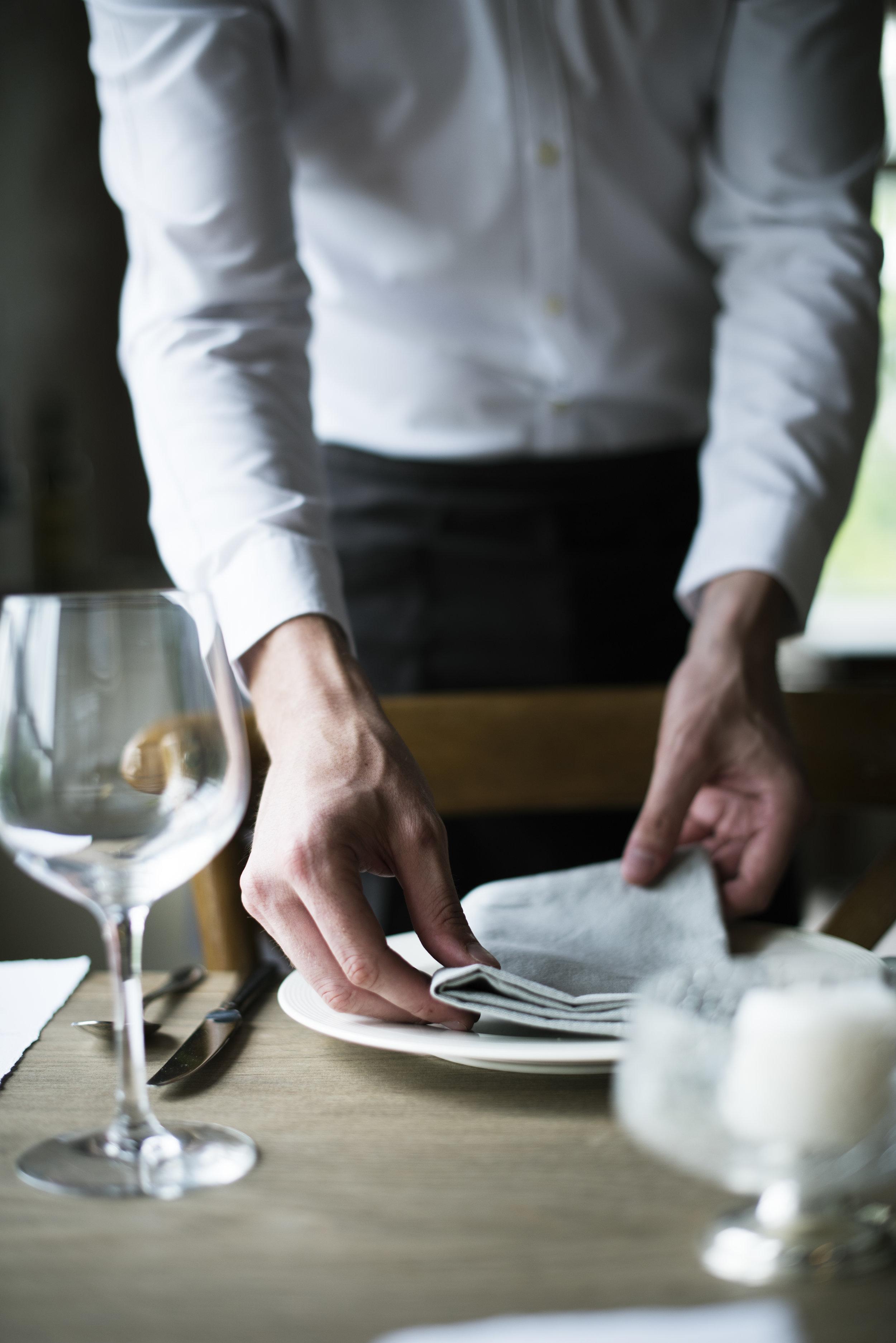 restaurant-staff-setting-table-in-restaurant-for-PJAKTJR.jpg