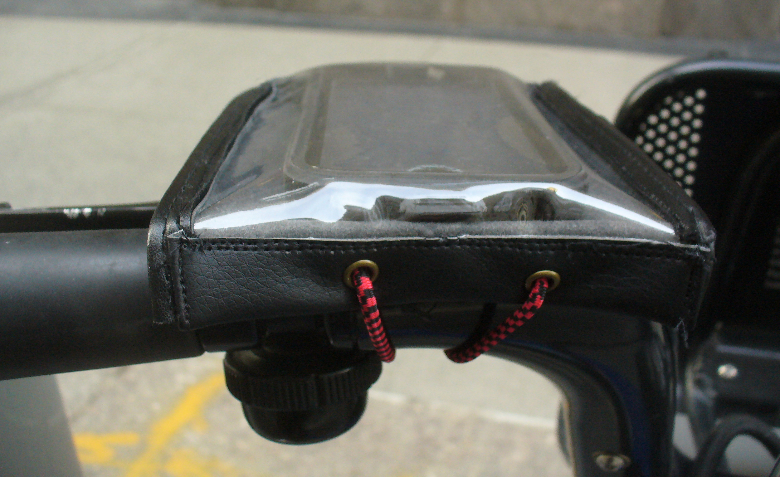 The holder keeps your phone snug and secure and quickly wraps around the handlebar of a Citibike (or any bike) with a bungee cord and clasp.
