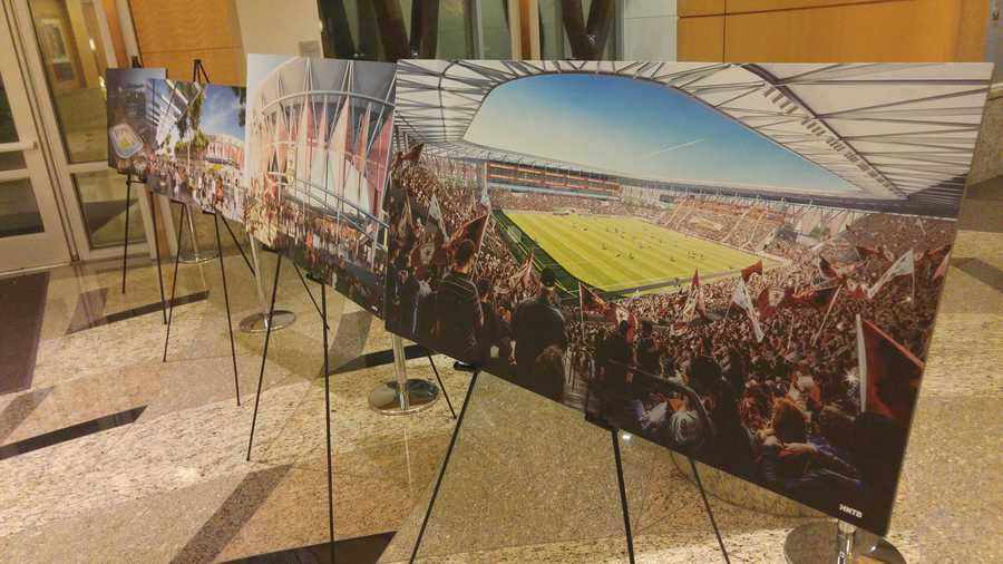 Renderings of a soccer stadium proposed to be built at the downtown Sacramento railyards were displayed on Tuesday, Dec. 1, 2015, at city hall. City council members voted to approve a term sheet for the stadium during its meeting that night.  SOURCE: Brandon Atchison/KCRA