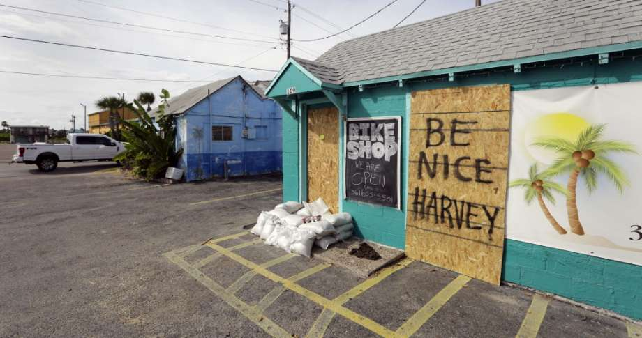 "A sign reading ""Be Nice Harvey"" was left behind on a boarded up business, Thursday, Aug. 24, 2017, in Port Aransas, Texas. Port Aransas is under a mandatory evacuation for Hurricane Harvey. Harvey intensified into a hurricane Thursday and steered for the Texas coast."