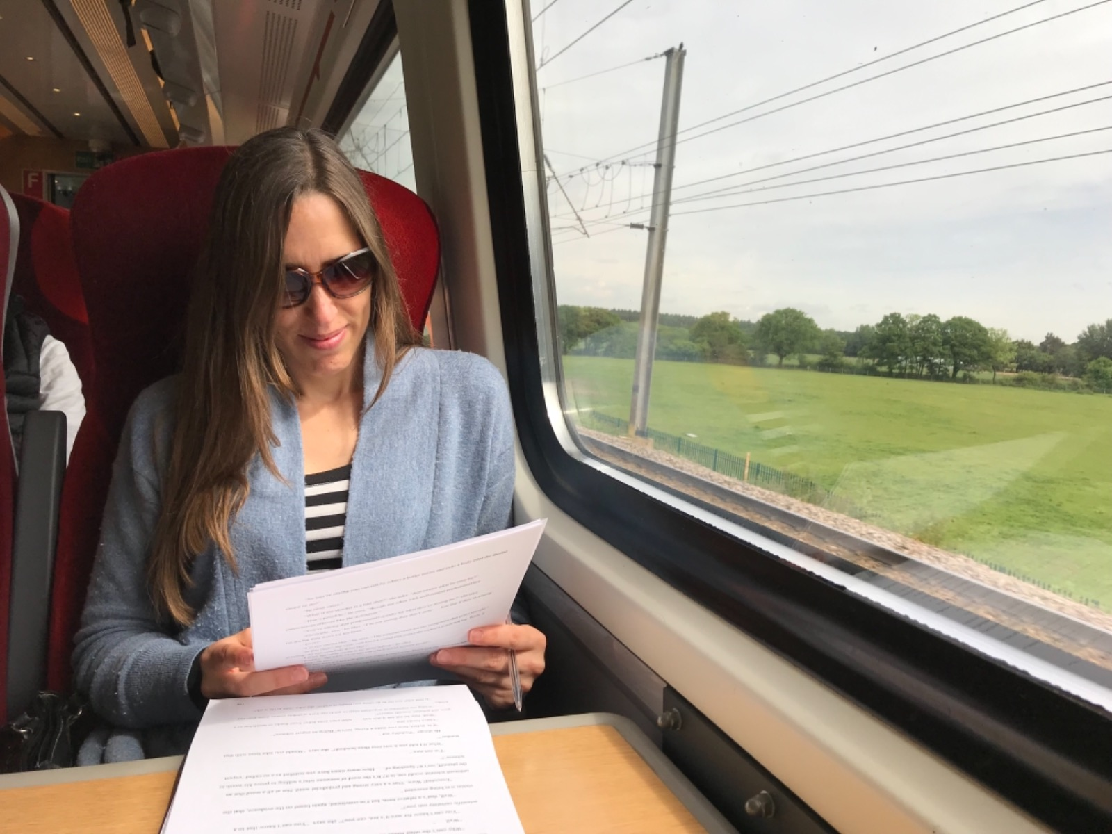 One of my lovely editors working on my new novel on a train to Edinburgh.