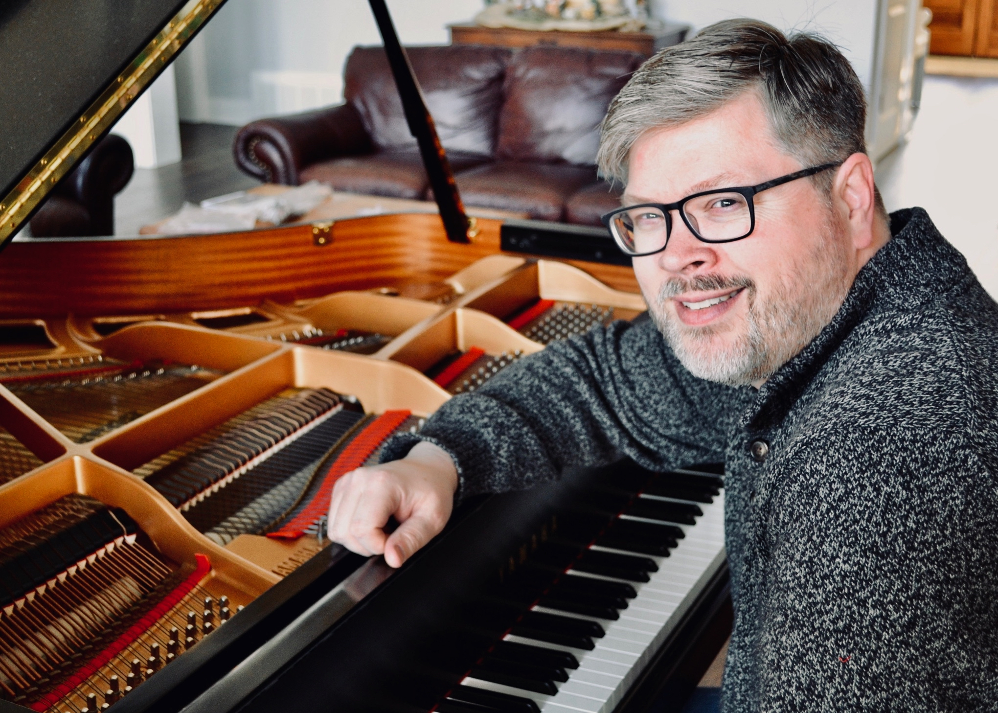 John Albert Thomas at the piano
