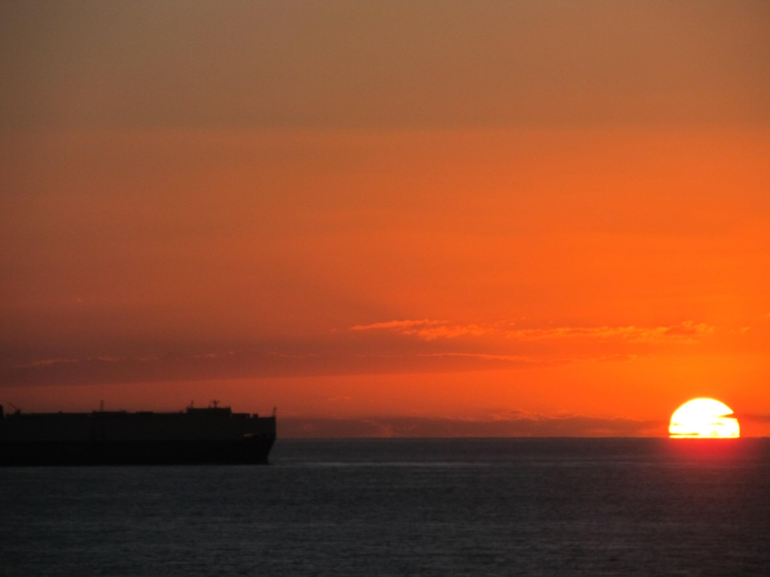 cargo ship at sunset