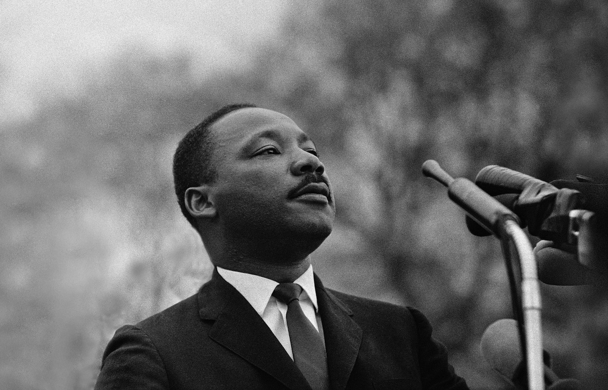 Dr. Martin Luther King, Jr. speaking before crowd of 25,000 Selma To Montgomery, Alabama civil rights marchers, in front of Montgomery, Alabama state capital building. On March 25, 1965 in Montgomery, Alabama. (Photo by Stephen F. Somerstein/Getty Images)