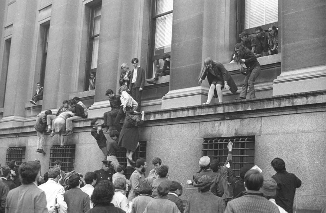 Students storming the ledge outside the office of Columbia University during their 1968 protest.