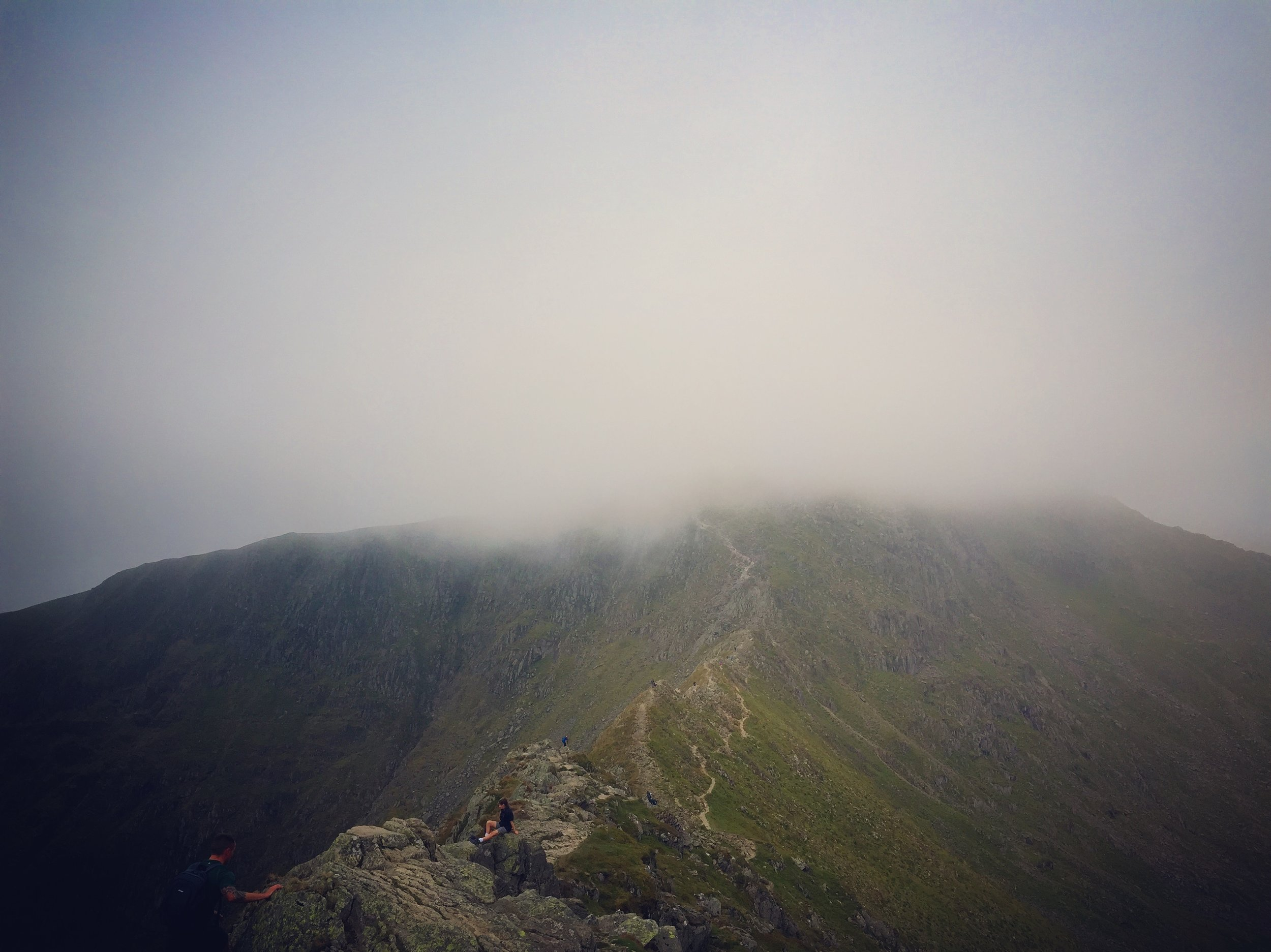 Striding edge with the summit of Helvellyn in clouds