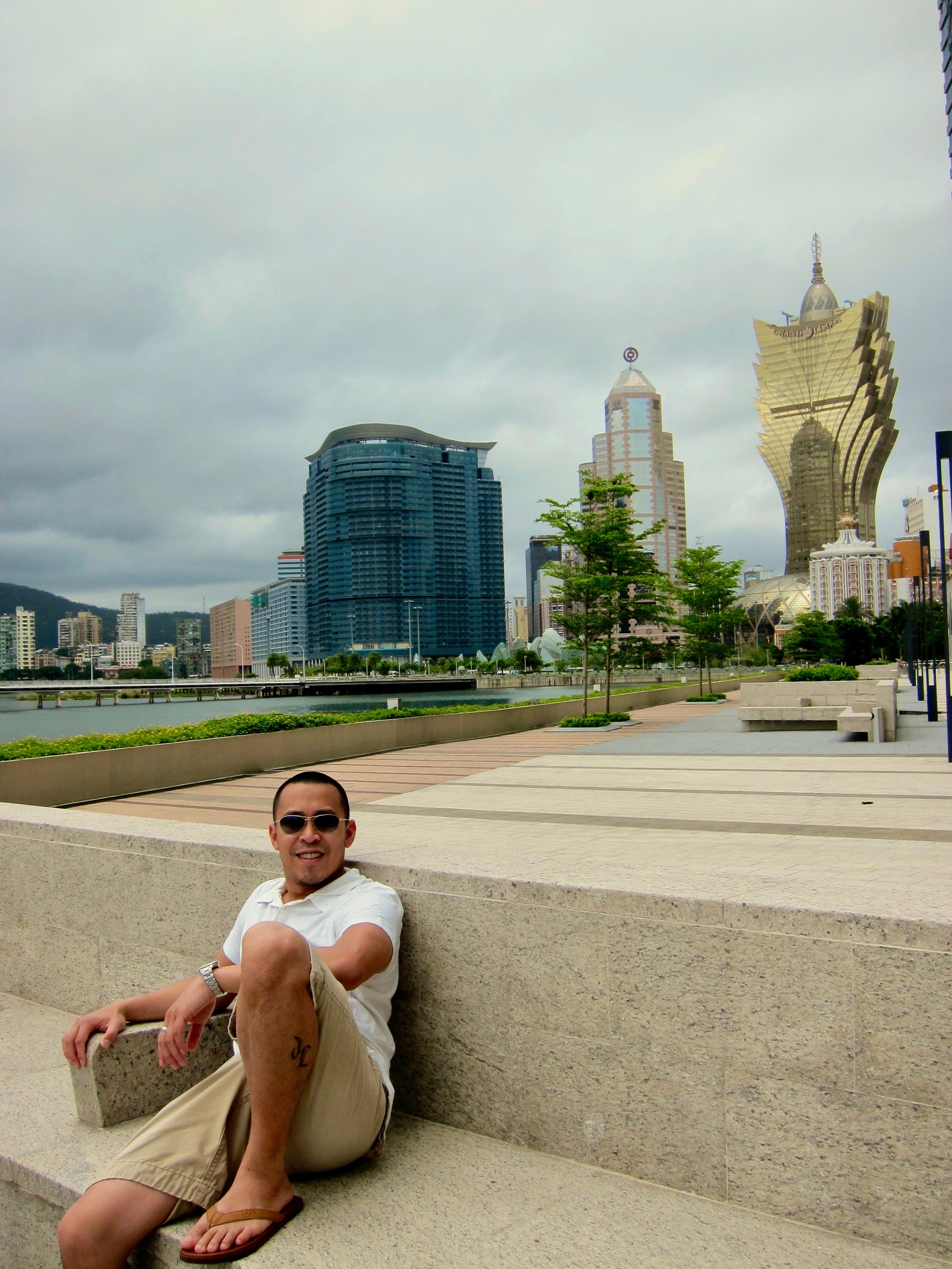 Chillin in Macau, with potentially the ugliest building (casino) ever built in the background....jpeg