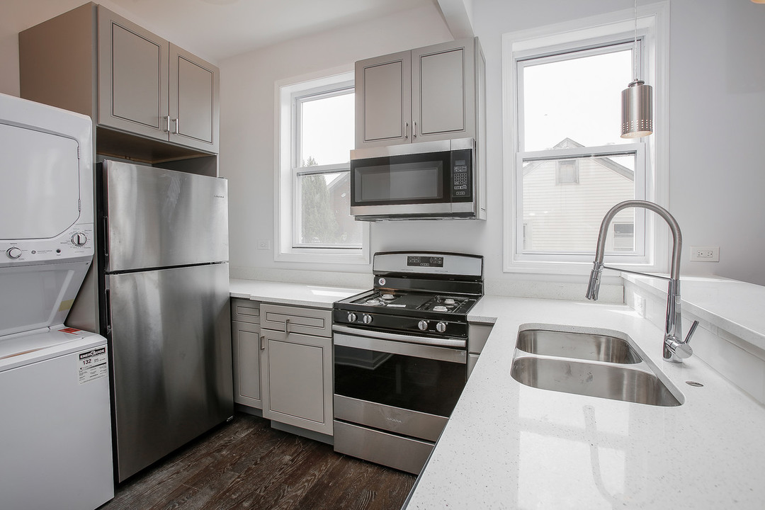 An off-market rehabbed Pilsen 4-Unit listed by Kevin Rocio.