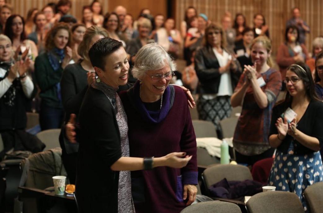 Martha Richards and Statera's Deputy Director, Shelly Gaza, make their way to the podium.