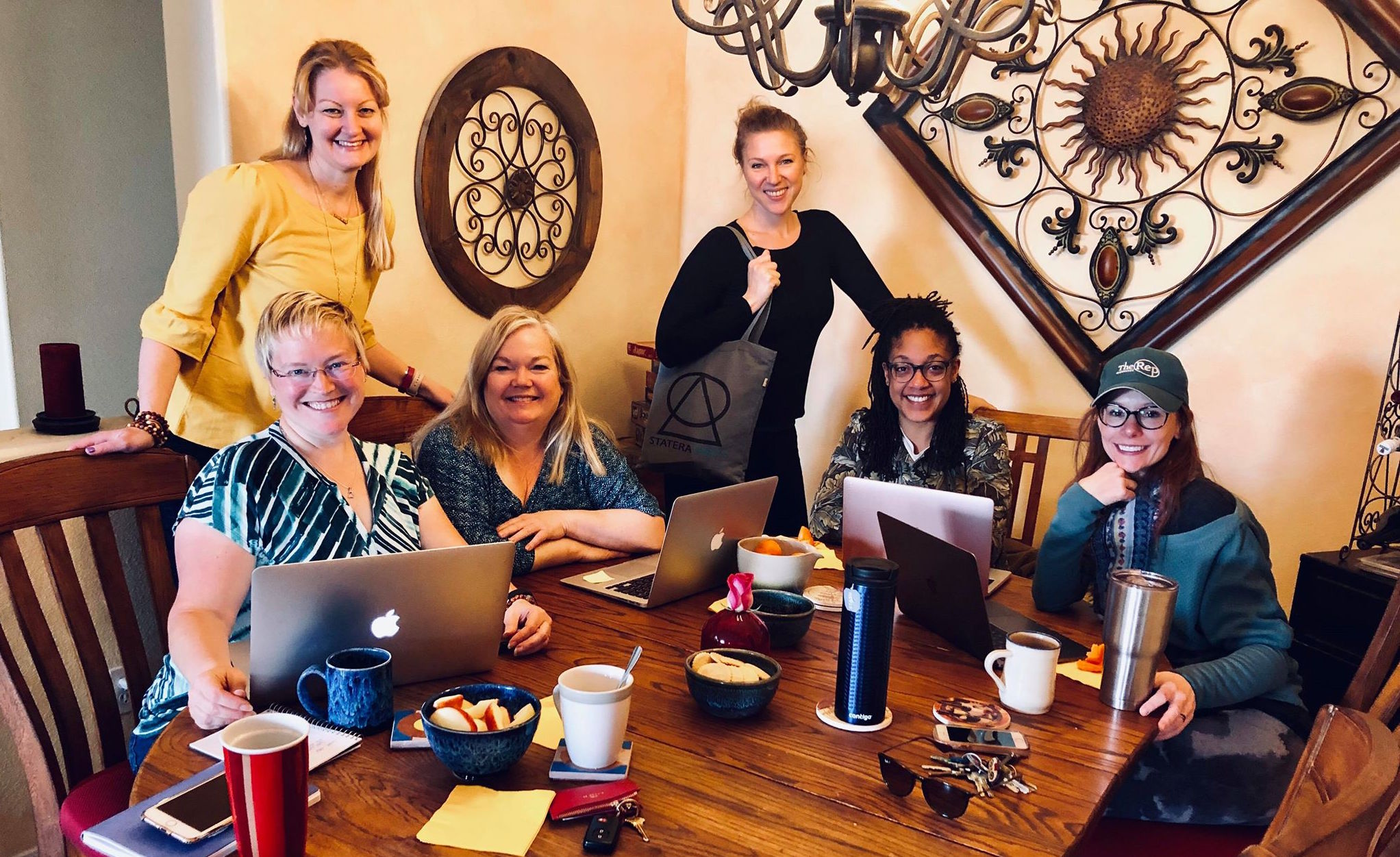 Statera Mentorship: Central Coast  regional coordinators during a recent meeting. Chrissy Collins (standing top-left) with (left to right) Z Jennifer Zornow, Kitty Balay, Karin Hendricks, Amani Dorn, and Emily Trask.