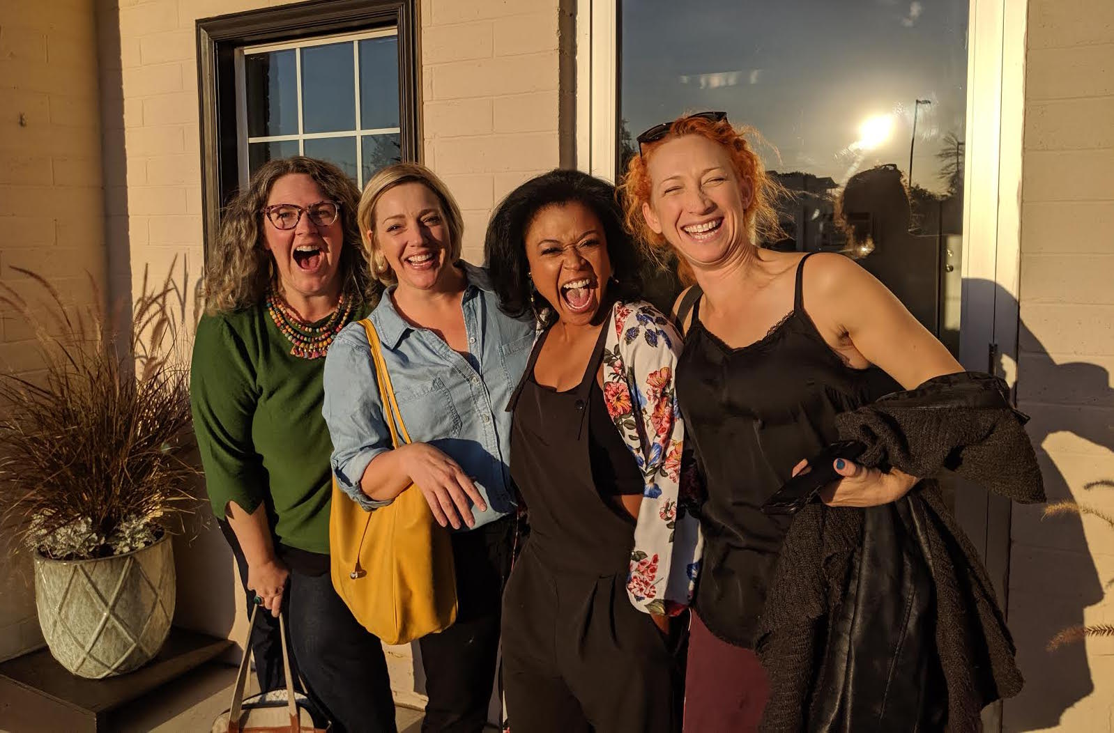StateraArts team members in front of the new office. From left to right: Sarah Greenman, Melinda Pfundstein, Sabrina Cofield, and Kate St. Pierre.