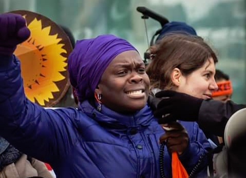 Sophie Dowllar Ogutu   speaking during a human rights march.