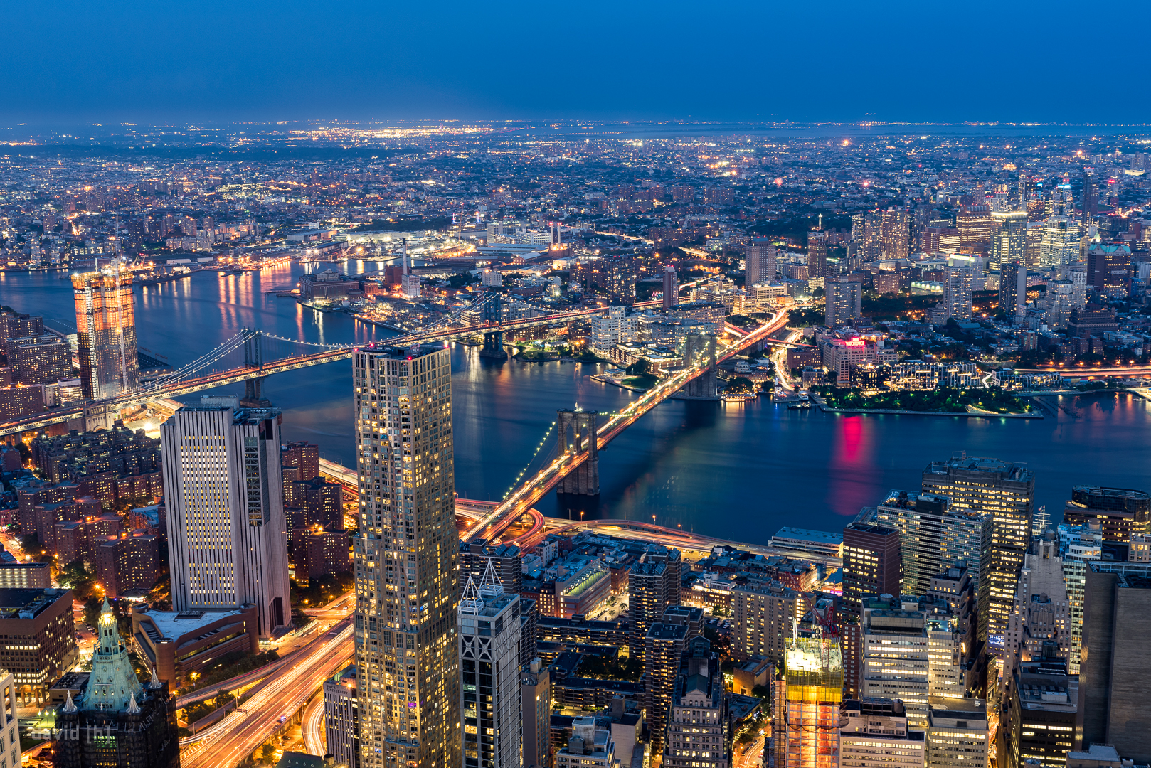 East River with Brooklyn and Manhattan Bridge during the blue hour of dusk, as seen from One World Observatory.