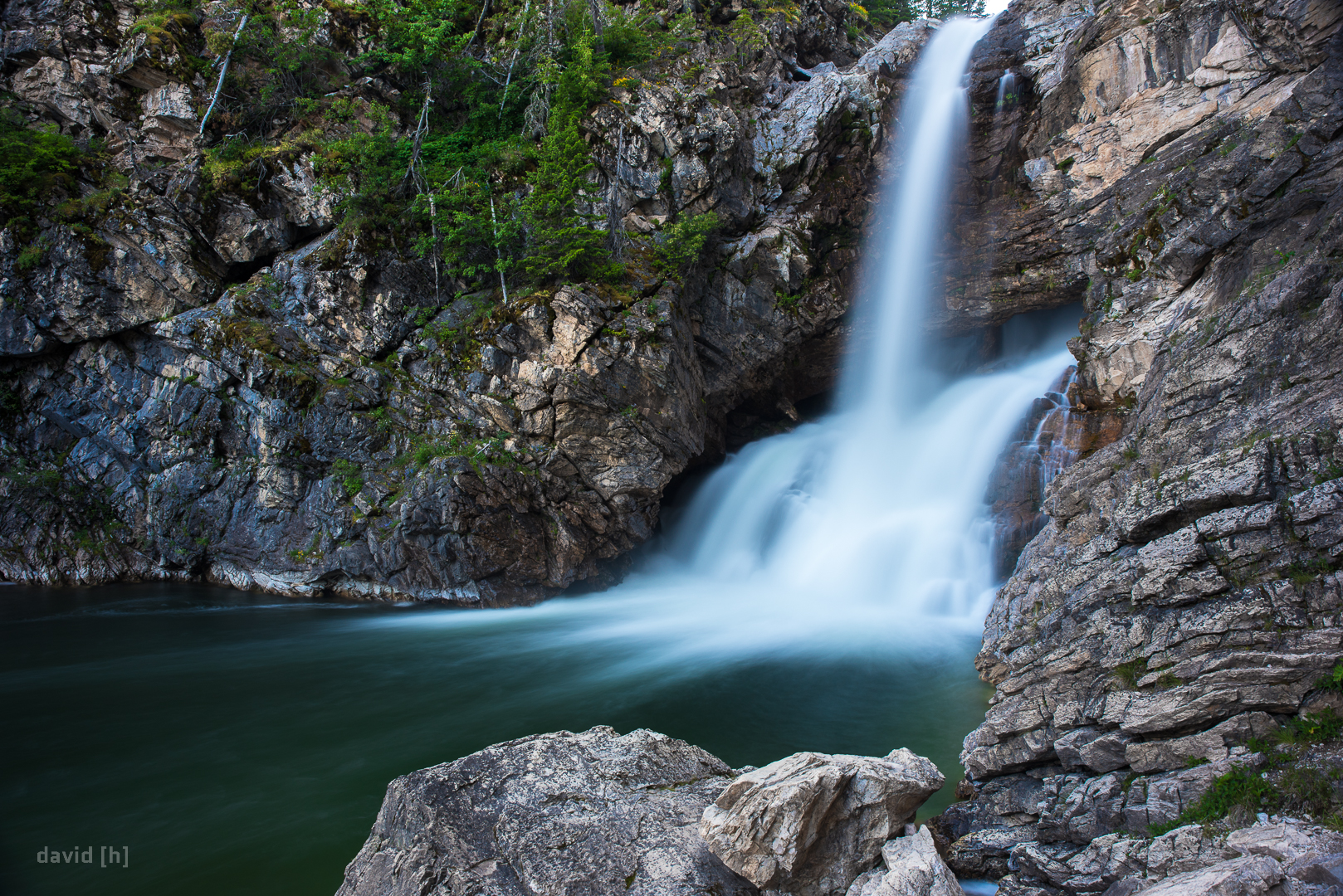 The Running Eagle Falls near Two Medicine Lake have a trick up their sleeve: They are actually two falls, one hidden behind the other. They are only visible individually only if there's a low flow of water coming from the top - otherwise the top waterfall would obscure the lower one.