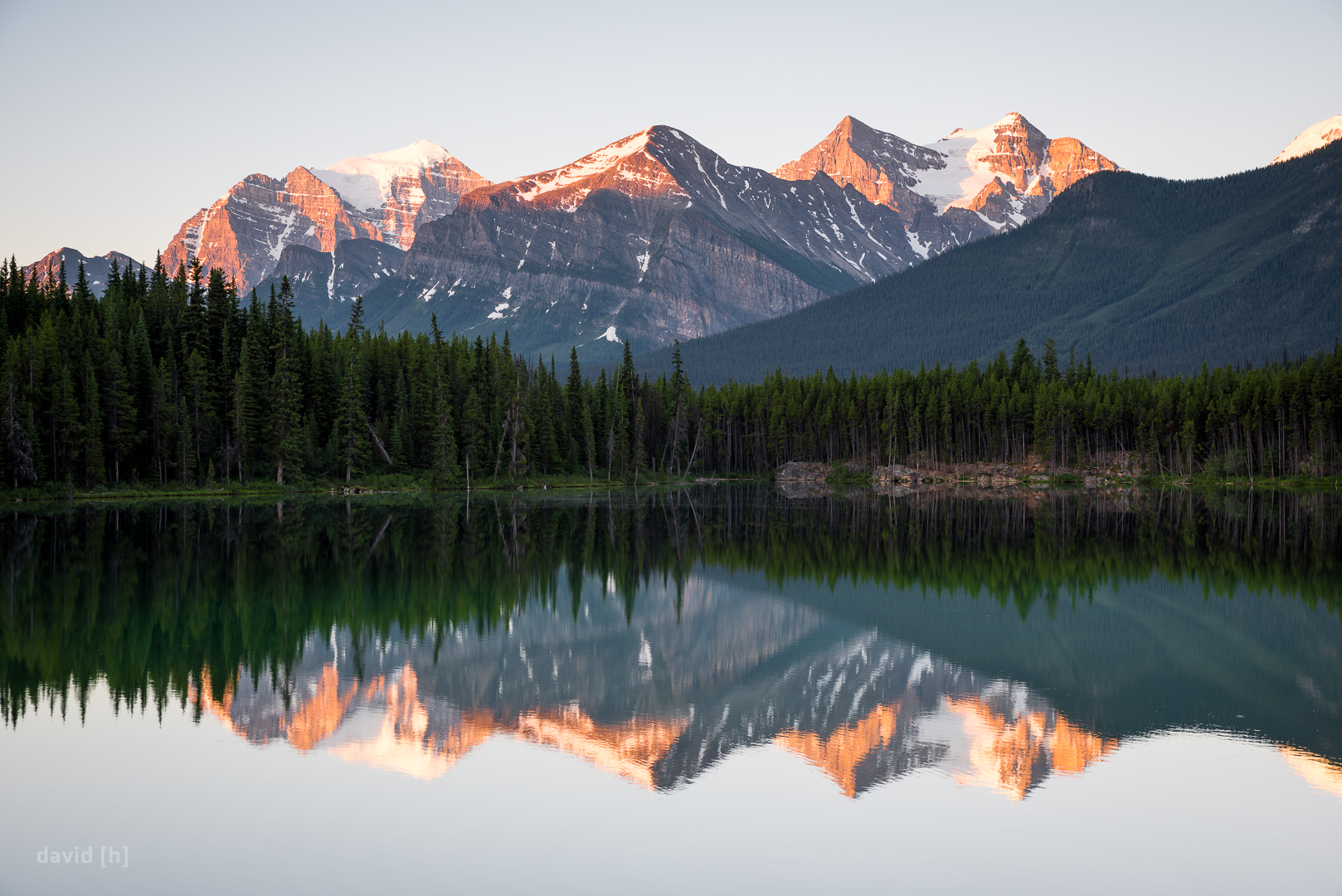 Sunrise reflections in Herbert Lake, allegedly the warmest lake in the entire Canadian Rockies, even sporting a diving board!