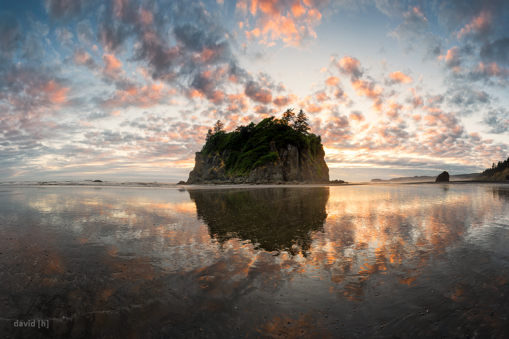 Sunset at Ruby Beach - perfect reflection due to the lowering tide leaving lots of water behind on the flat beach.