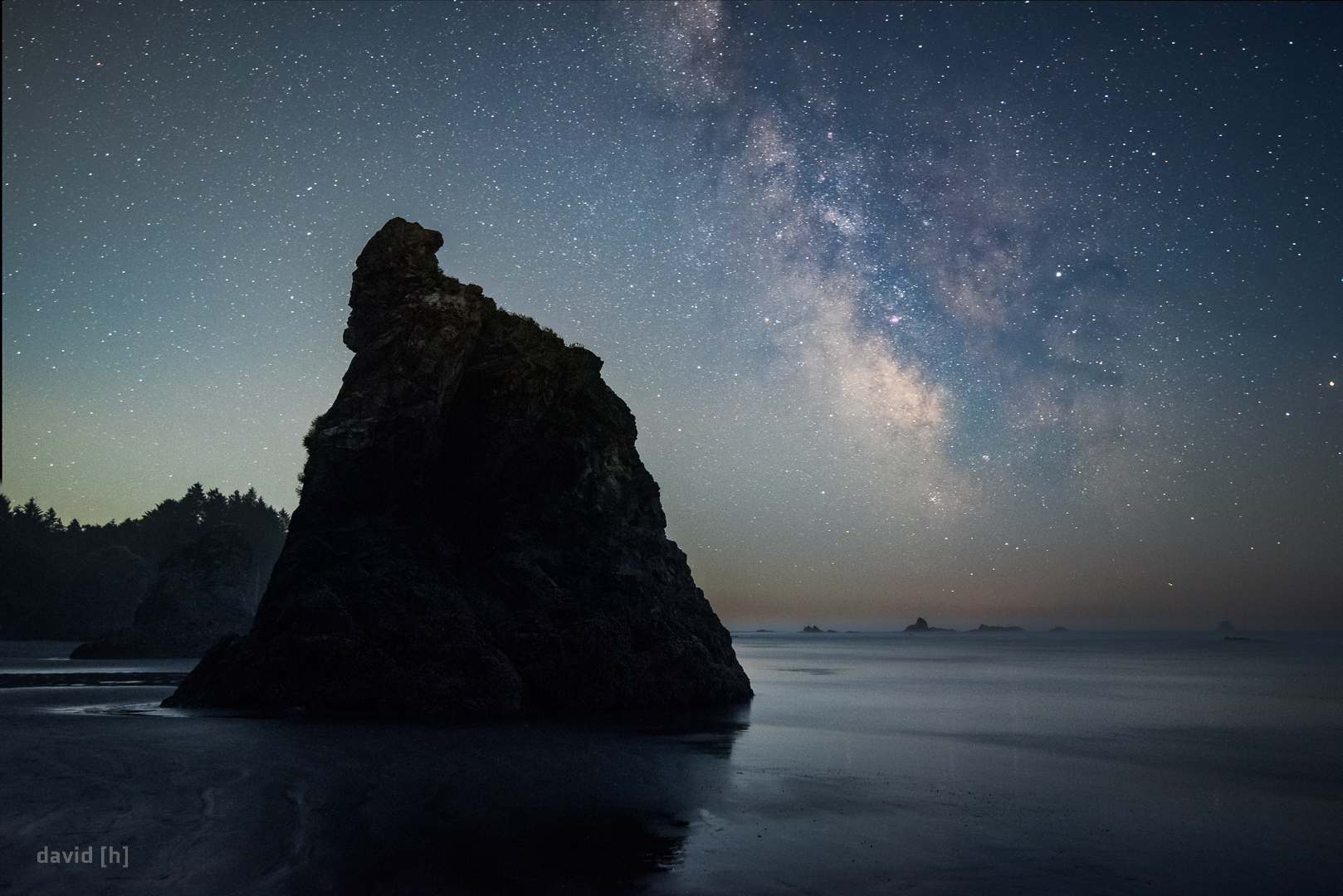 The Milky Way next to a sea stack at Ruby Beach. The rising moon starts illuminating the sky from the left, and soon thereafter would wash out the stars completely.