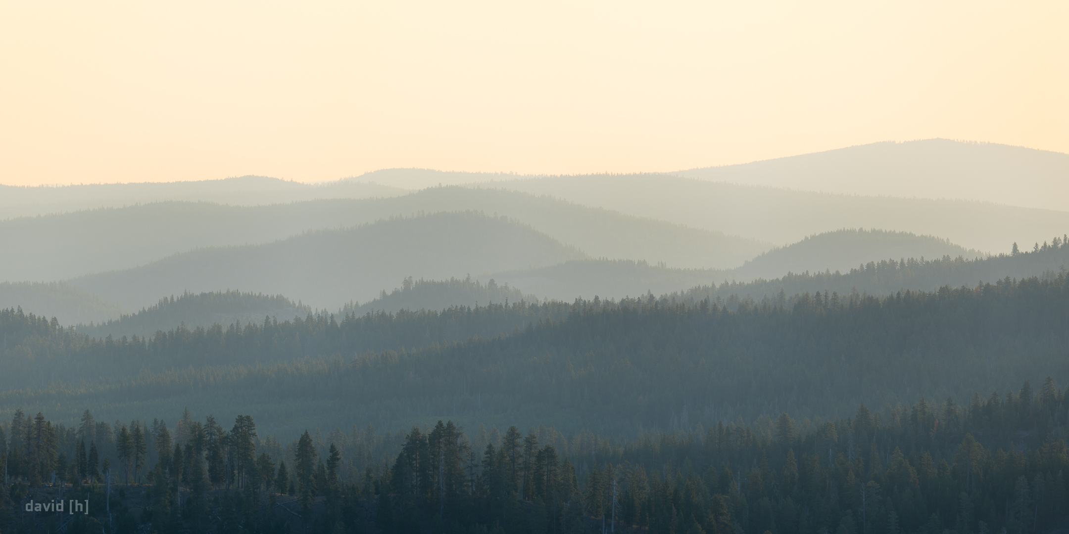 The forests in the distance of Cinder Cone are slighly obscured by layers of haze shortly after sunrise.
