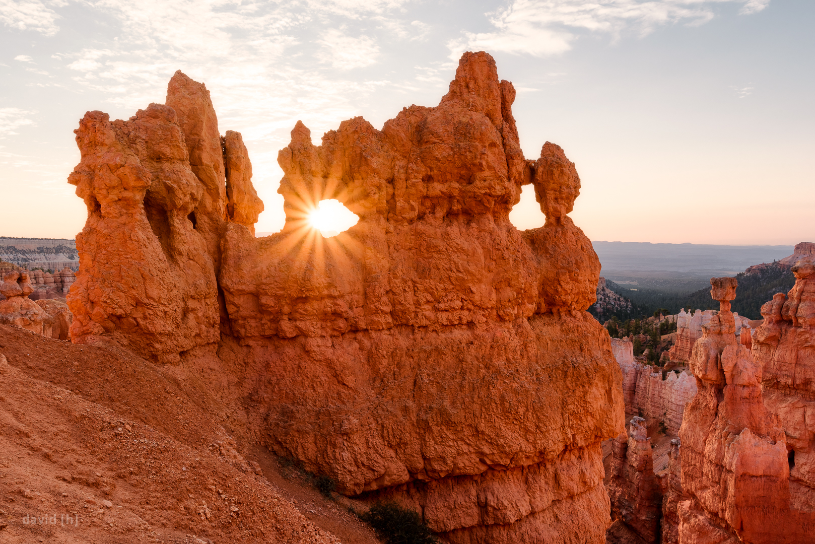 The sun peaks through one of the many windows found in the rock formations in Bryce Canyon. All you have to do is get off the beaten path and you'd be surprised what you'll find!