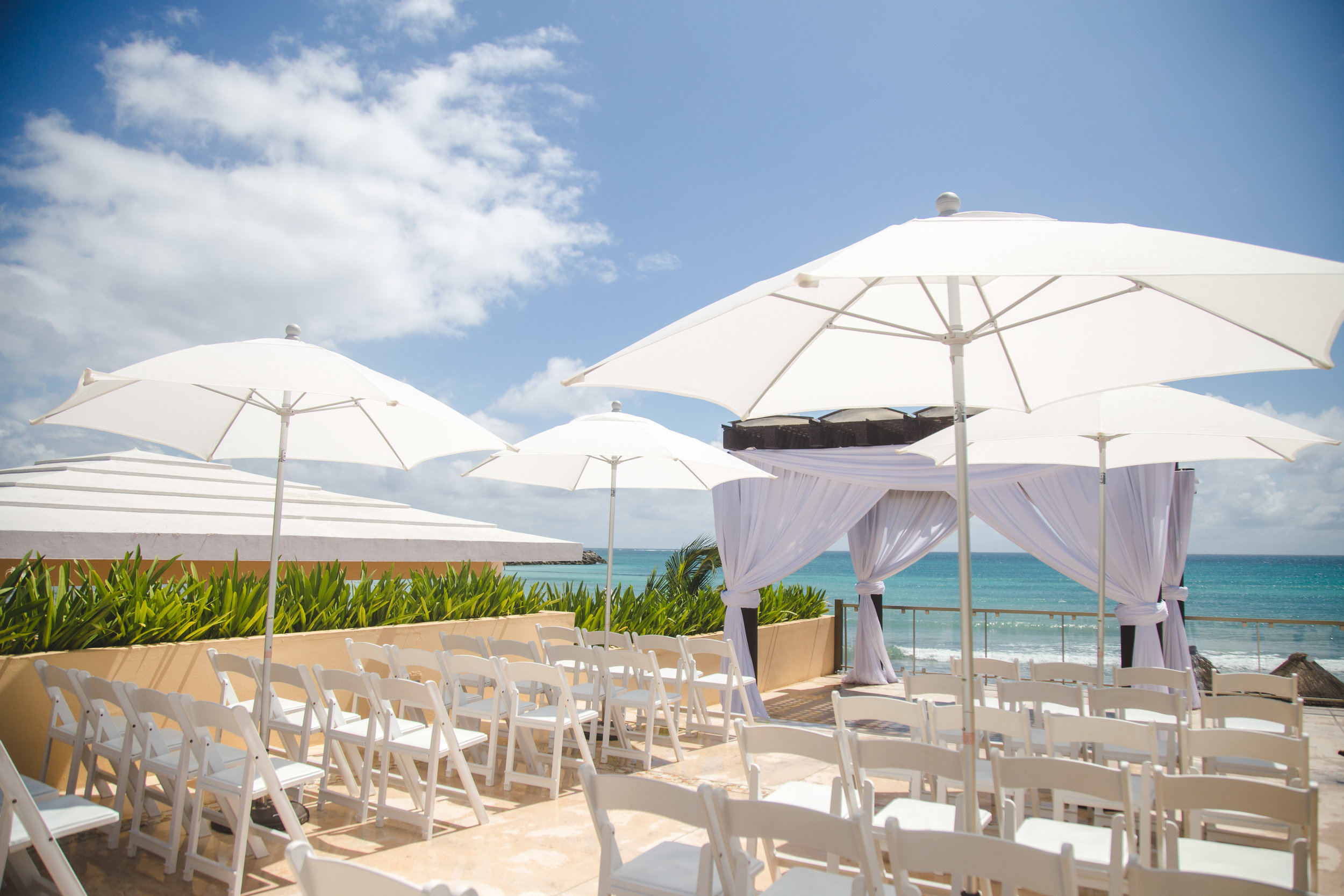 PERGOLA IN WHITE WITH UMBRELLAS II.jpg