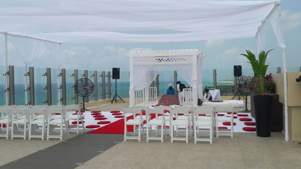 sky deck Indian ceremony with red cushions and red carpet.jpg