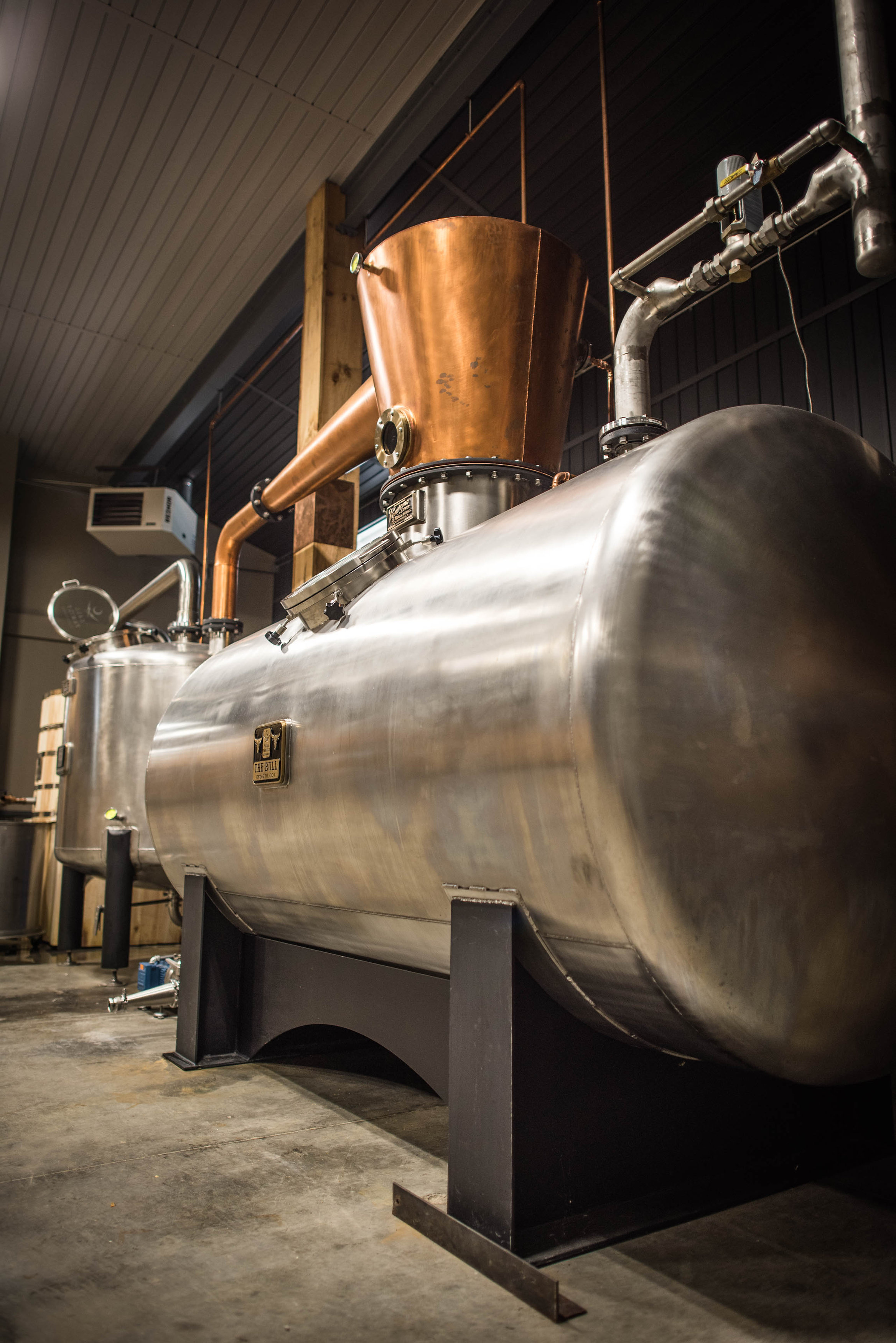 """""""The Bull"""" - Our custom designed 2100 gallon direct steam injection still. Designed by master distiller, Brian Call - it is the largest direct steam injection still in North Carolina. Built in 2015 by  Vendome Copper & Brass Works."""