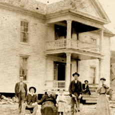 Reverend Dan Call and family in front of the Call homestead in Lynchburg, TN - late 1800's