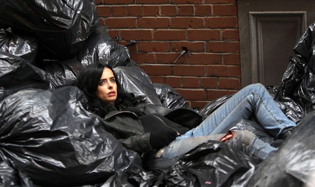 Krysten Ritter makes lying in trash look good.