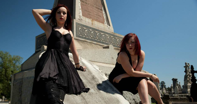 Photo of The Soska Sisters from a graveyard photoshoot.