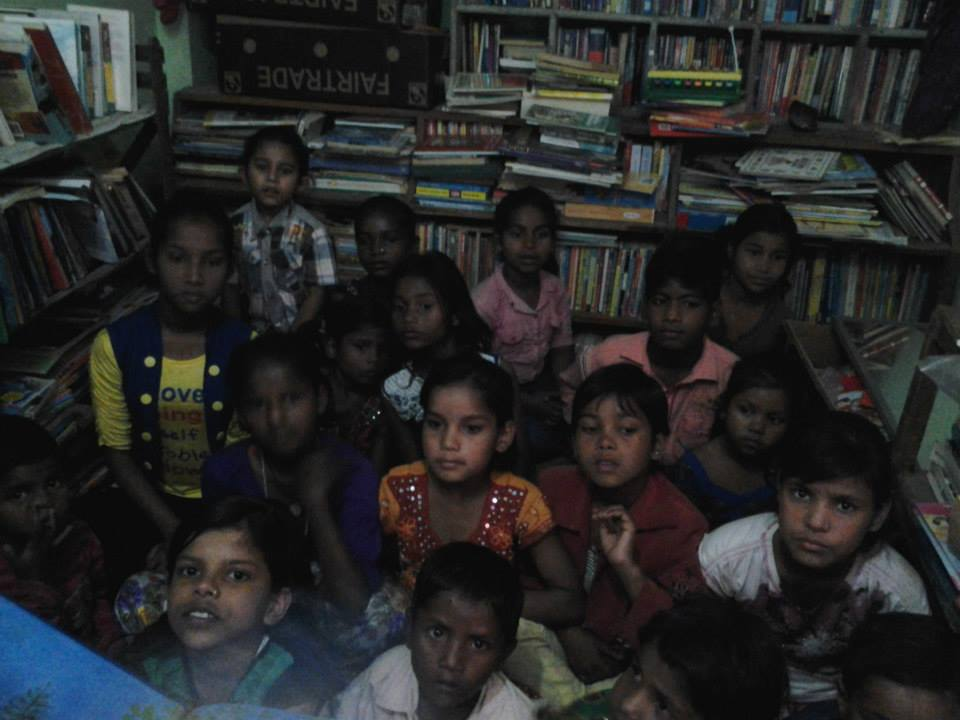 Children enjoying their community library at the Baljeet Nagar School.