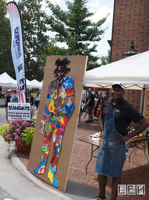 Steve Prince with 1 completed Art project August 2019 with 2nd Sundays Street sign & banner in photo.jpg