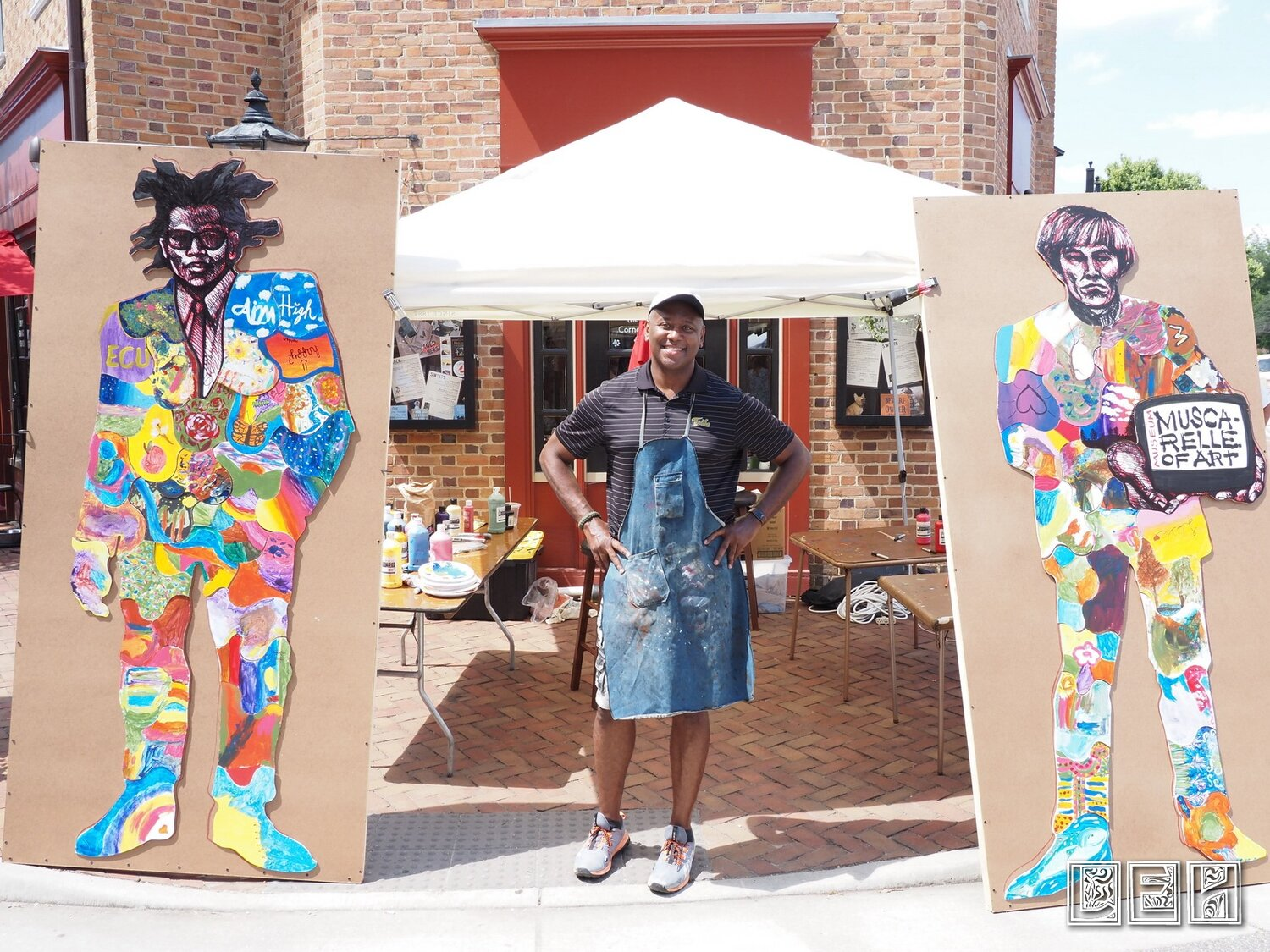 Steve Prince with 2 completed Community art Projects Aug 2019.jpg