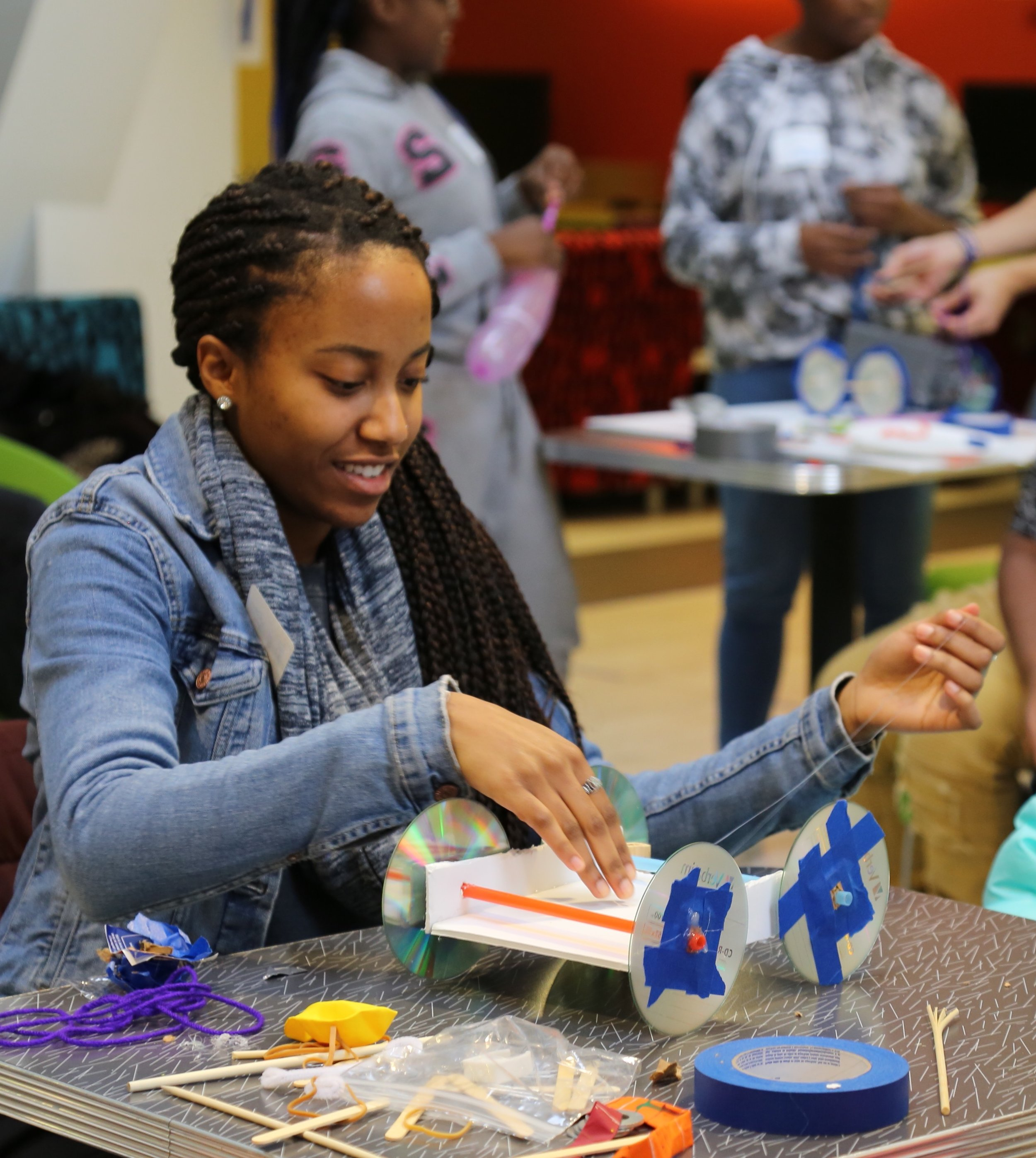 Our Mission - Studio: TESLA mobilizes college students to establish dynamic after-school activities for underserved youth to build STEAM literacies and critical-thinking capacity through hands-on design challenges.