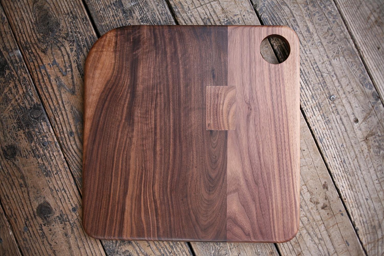 Walnut cutting board with asymmetrical corners.